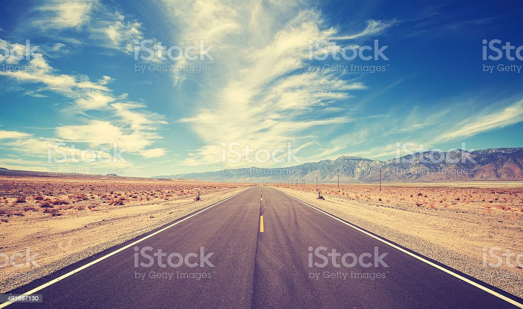 Vintage style country highway in USA, travel adventure concept. stock photo