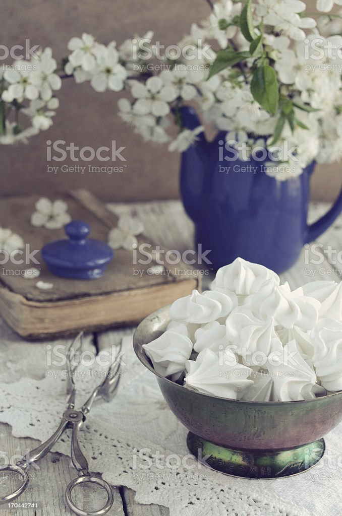 Vintage style decoration with meringue kisses and cherry flowers royalty-free stock photo
