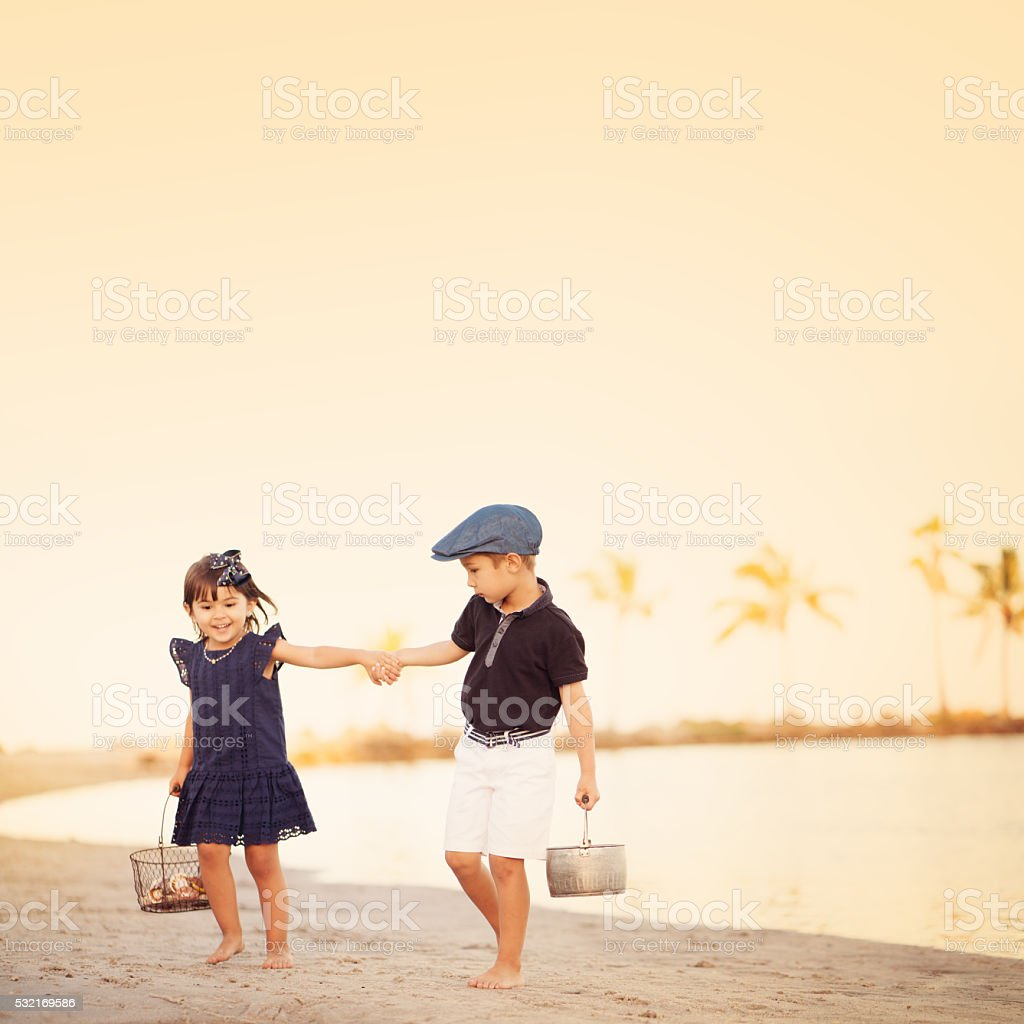 Vintage style kids at the beach stock photo