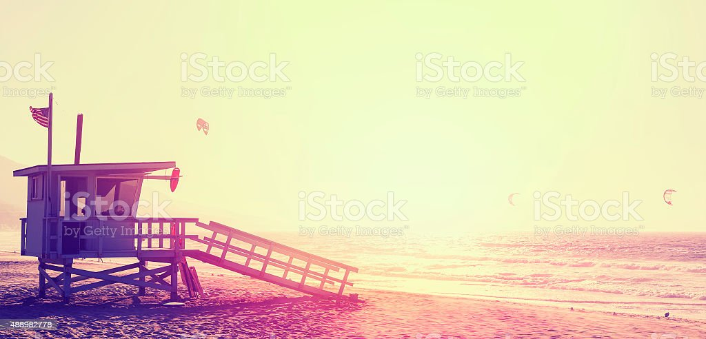 Vintage style lifeguard tower at sunset in Malibu, USA. stock photo