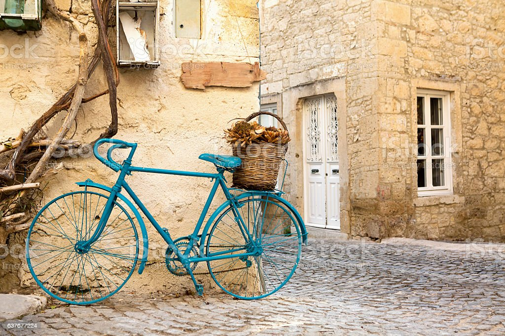 Vintage Style Light Navy Painted Bicycle in Alacati Streets stock photo