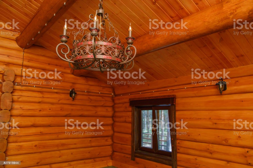 Vintage style metal lamp is Dangling on a wooden ceiling stock photo