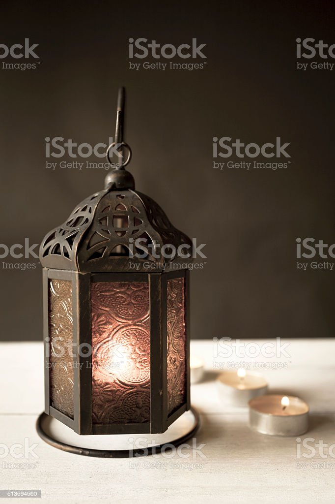 Vintage style metal lantern with candle stock photo