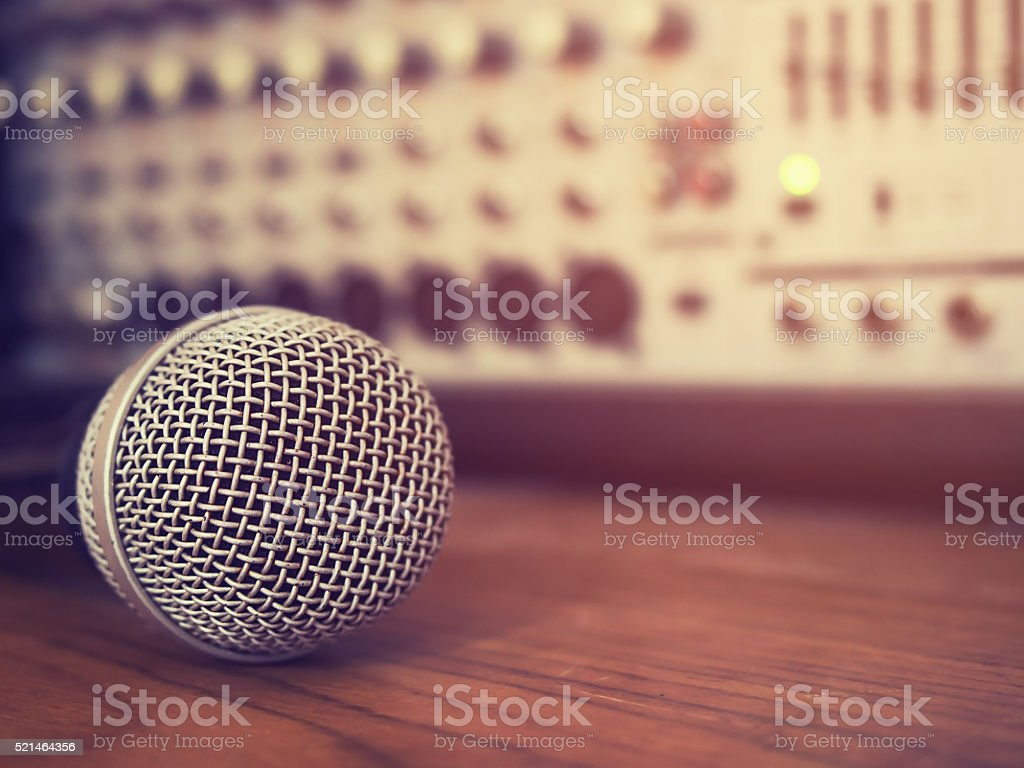 Vintage style photo of the microphone in recording studio . stock photo