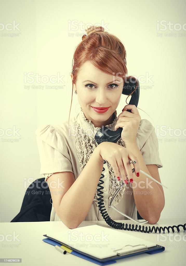 Vintage style redhead girl on the phone royalty-free stock photo