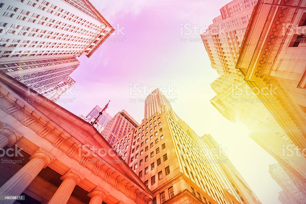 Vintage style Wall Street at sunset. stock photo