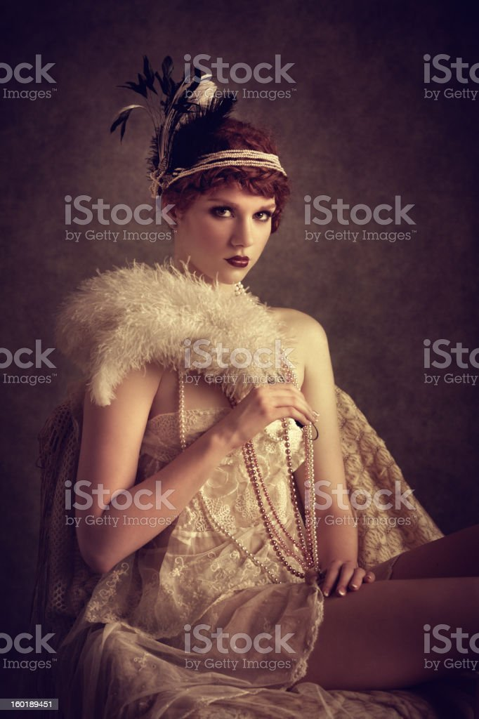 vintage style woman with feather fan royalty-free stock photo