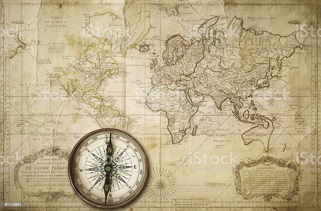A vintage style world map with compass stock photo