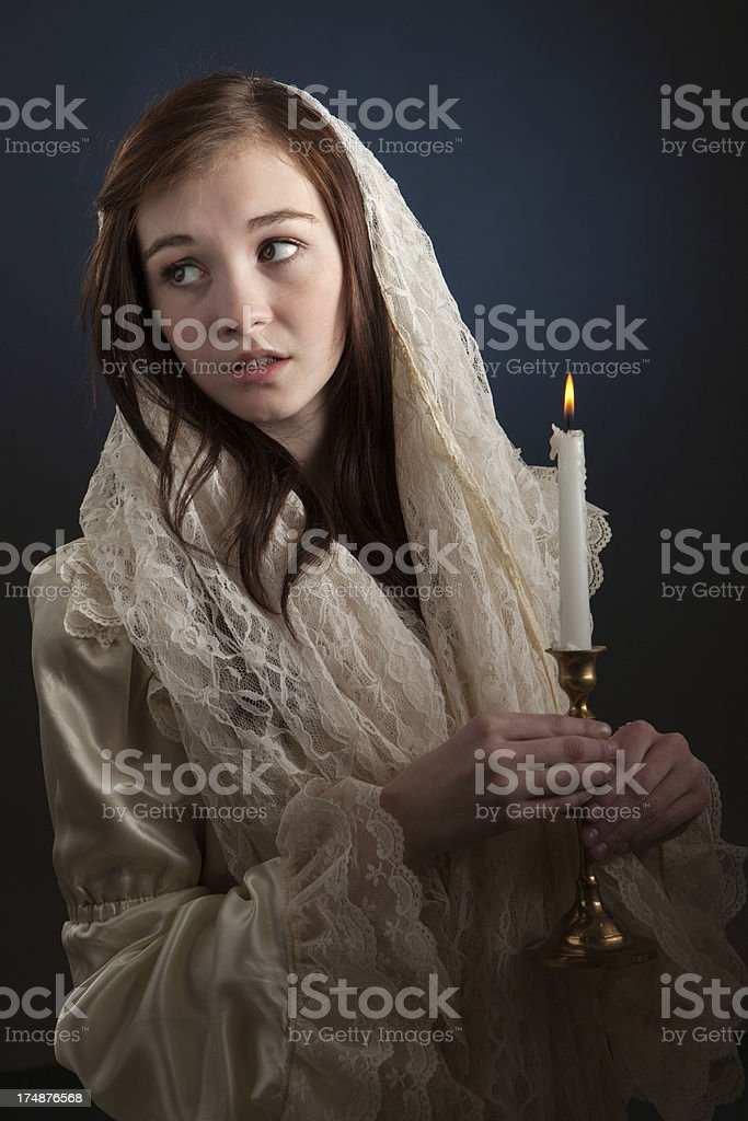 Vintage Style Young Woman Holding Candle stock photo