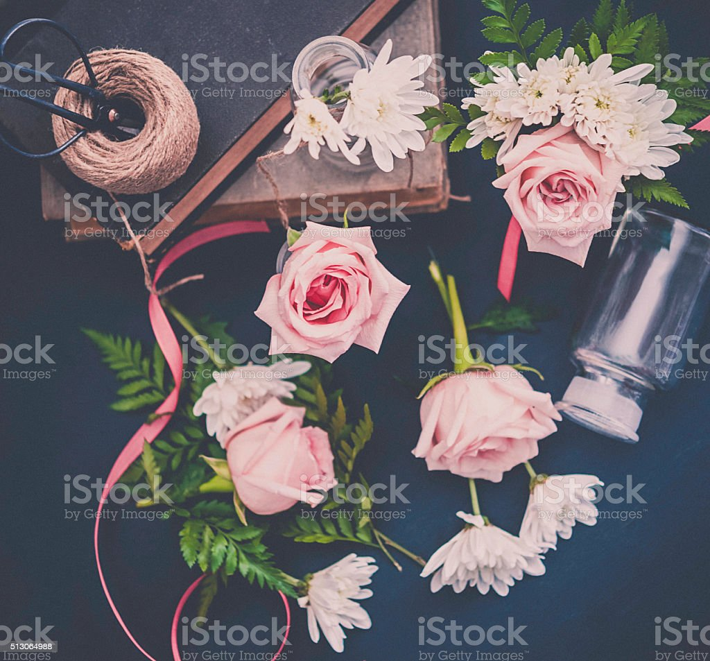 Vintage styled still life of flower arranging royalty-free stock photo
