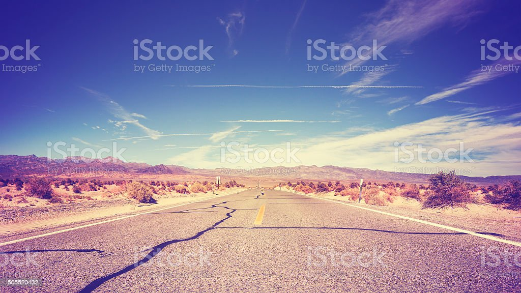 Vintage stylized endless country highway, USA. stock photo