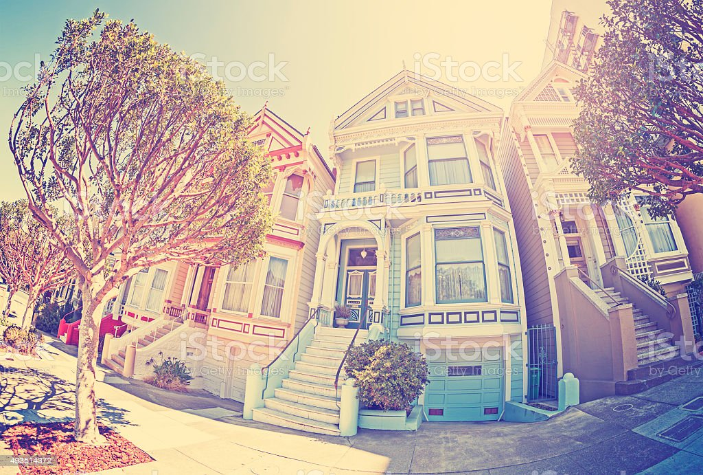 Vintage stylized fisheye lens street photo of Painted Ladies. stock photo