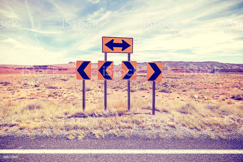 Vintage stylized photo of road signs, choice concept. stock photo