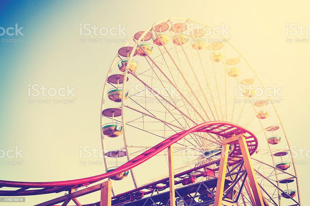 Vintage stylized picture of an amusement park. stock photo