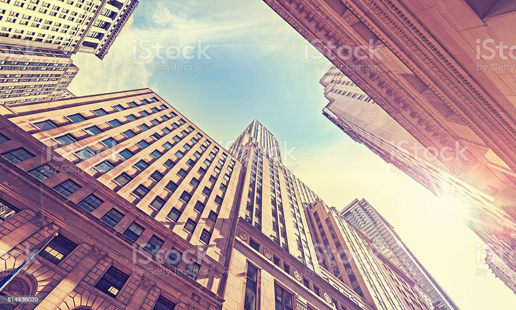 Vintage stylized Wall Street at sunset with lens flare effect. stock photo