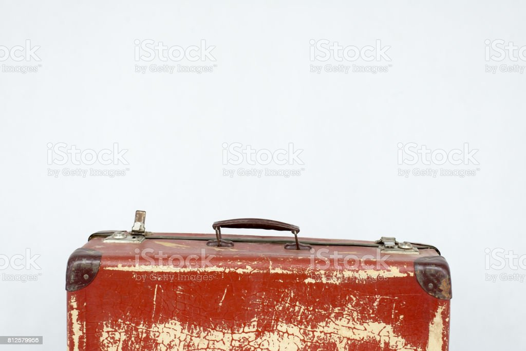 Vintage suitcase made of cardboard with hardware. Selected focus. stock photo