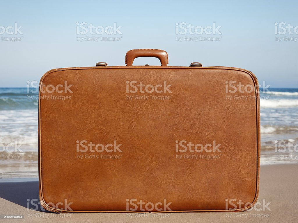 vintage suitcase on the beach stock photo