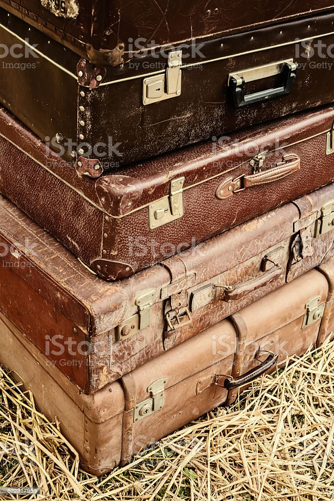 Vintage suitcases on hay stock photo