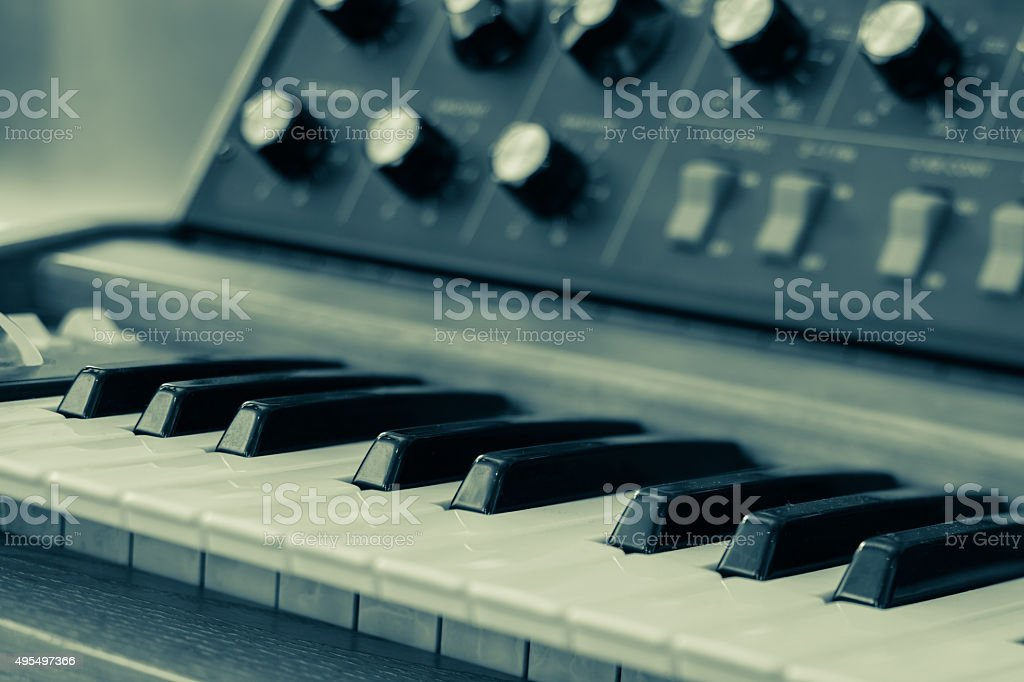 Vintage synthesizer keyboard musical instrument stock photo