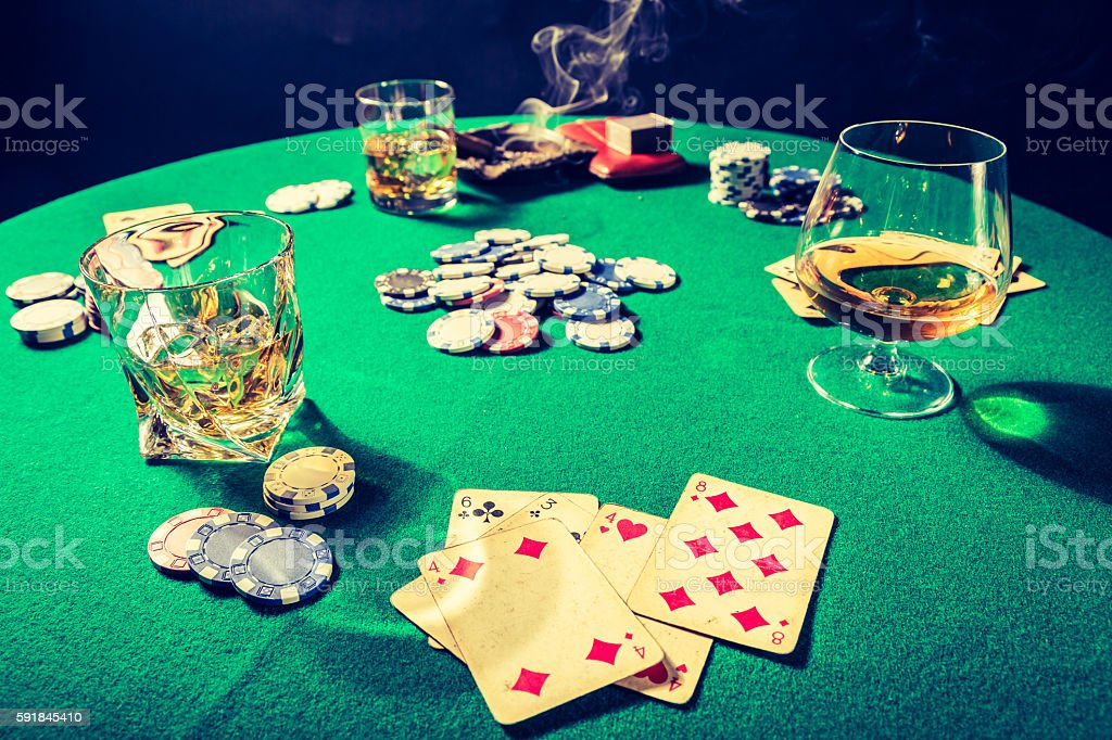 Vintage table for poker with whiskey, cigar and cards stock photo