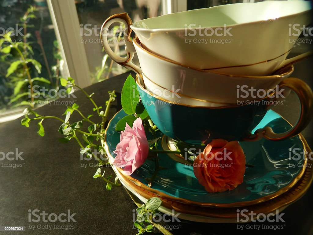 Vintage Tea Cups in A Sunny Kitchen stock photo