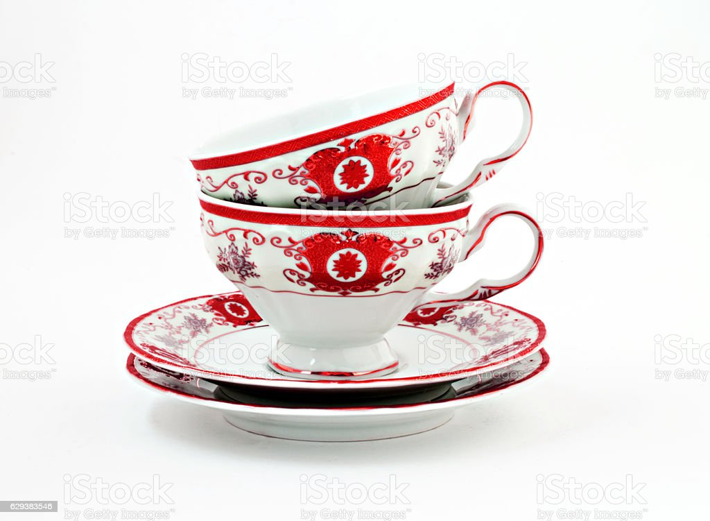 vintage tea set with gold red decor isolated stock photo