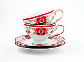 vintage tea set with gold red decor isolated