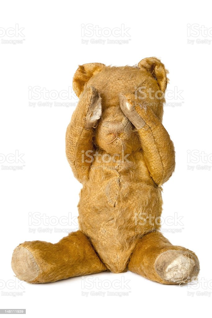 Vintage Teddy Bear covering Eyes, over White royalty-free stock photo