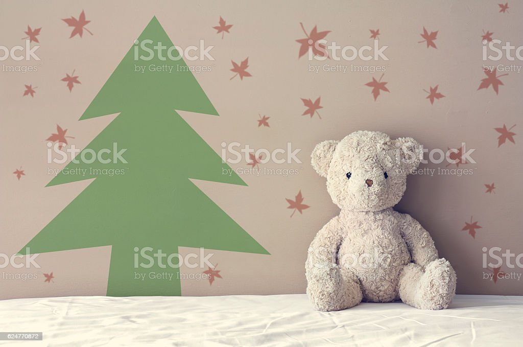 vintage teddy bear sit on the right side white bed stock photo