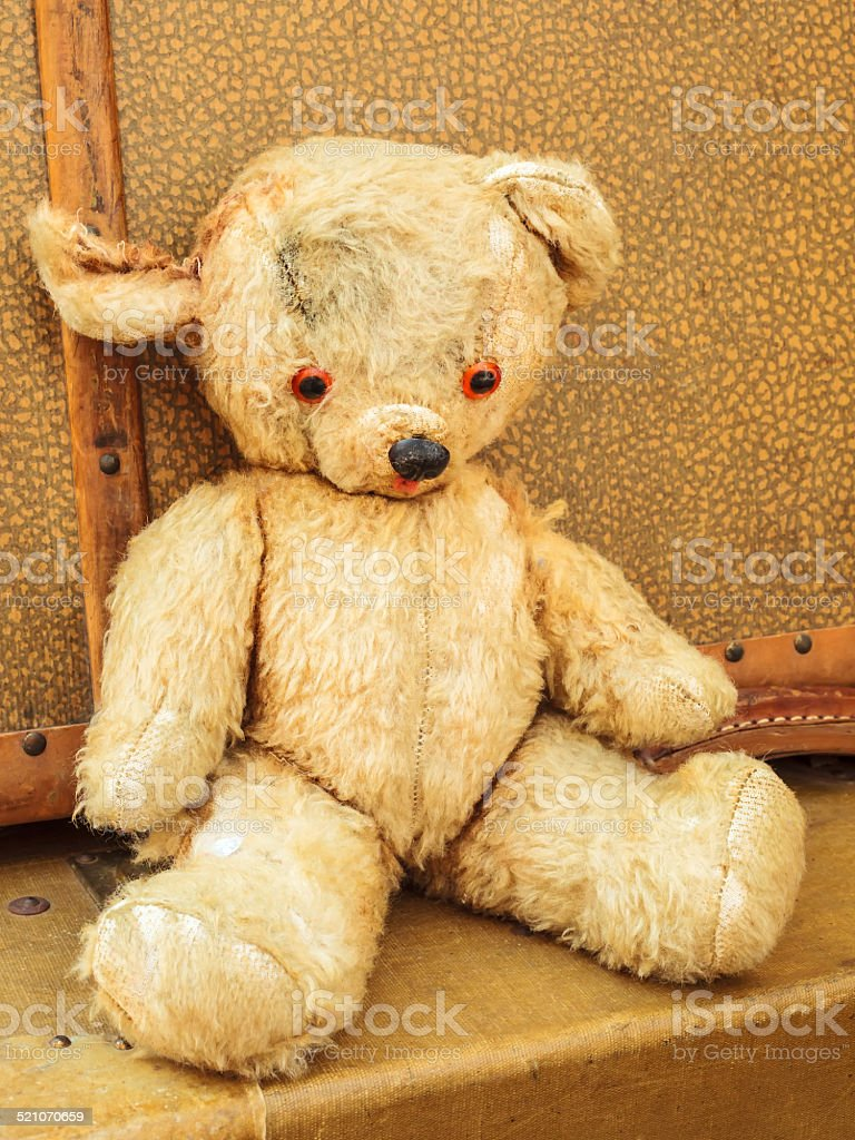 Vintage teddy bear with old suitcases stock photo