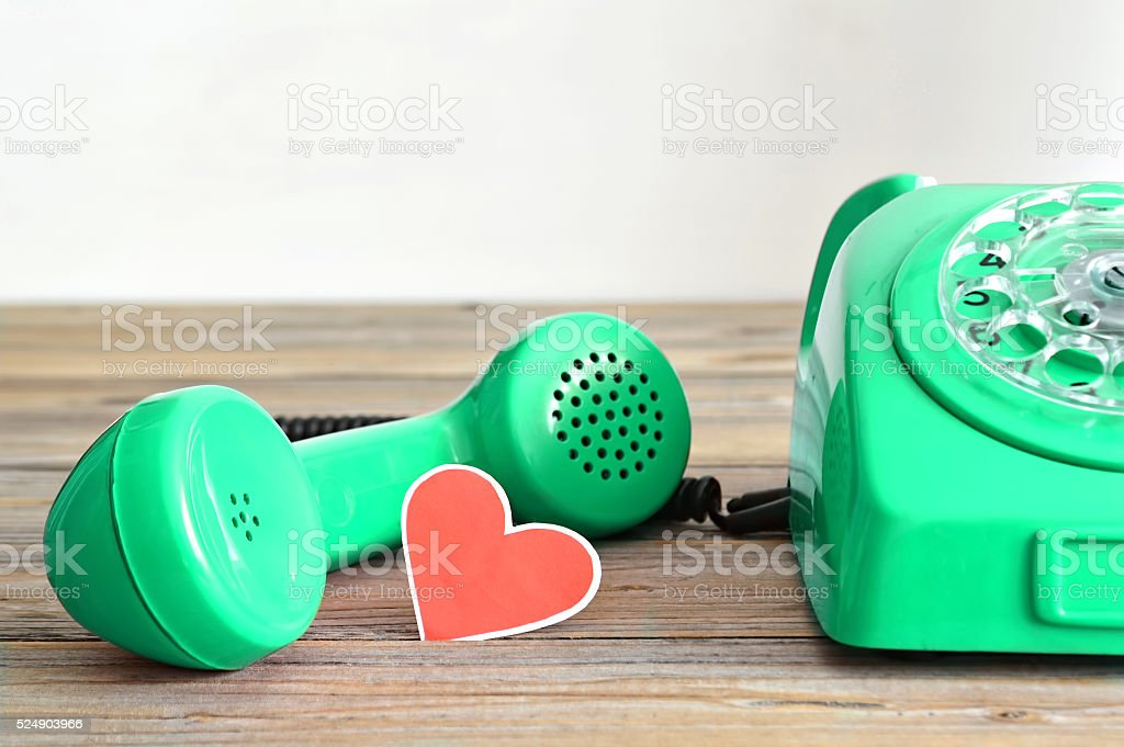 Vintage telephone and heart  shaped tag stock photo