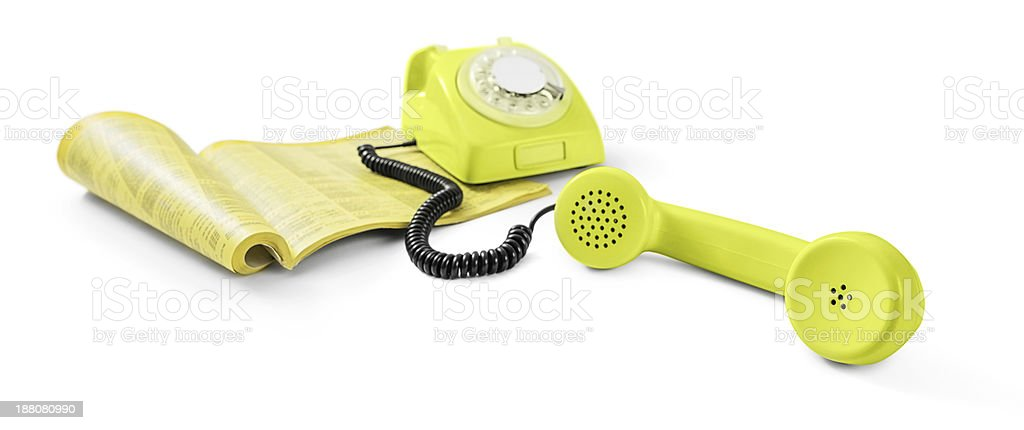 Vintage telephone and phone directory stock photo