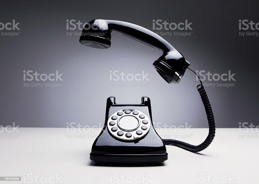 Vintage telephone over dark background stock photo