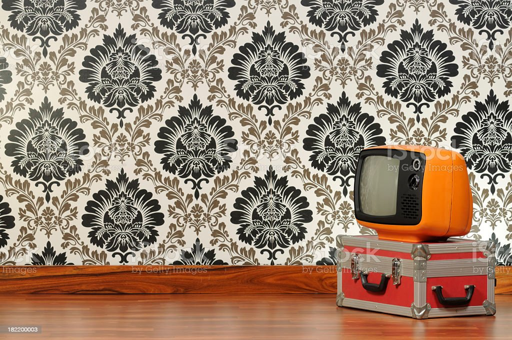 Vintage television in front of a Damascus wallpaper royalty-free stock photo