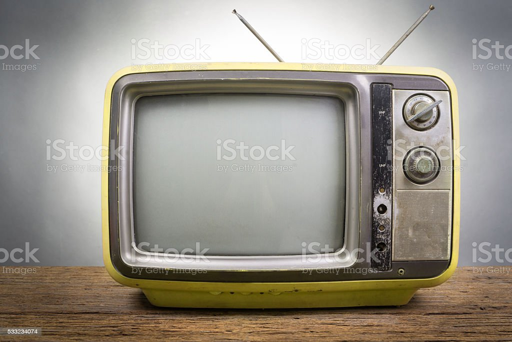Vintage Television on wood table stock photo