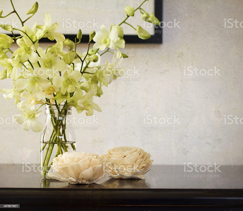 Vintage texture background with orchids in vase stock photo