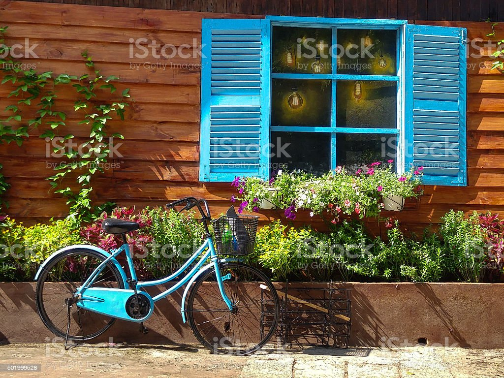 vintage theme with bike side the blue window stock photo