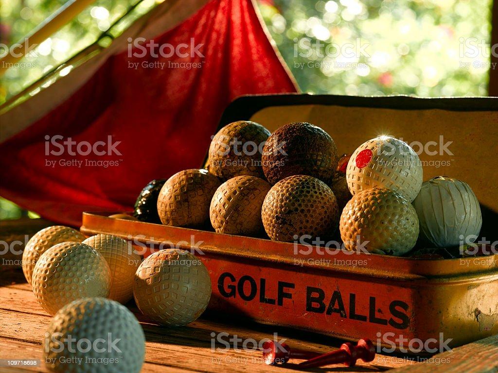 Vintage Tin of Early Era Golf Balls royalty-free stock photo