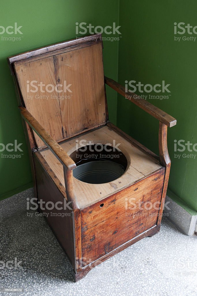 Vintage toilet made of wooden armchair and bucket stock photo