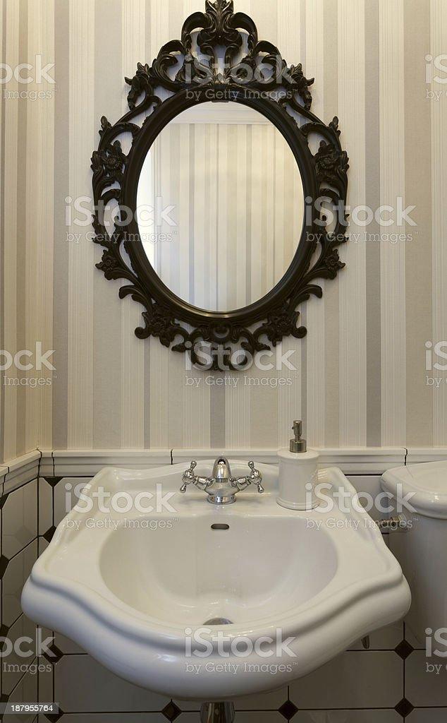 Vintage toilet with a mirror stock photo