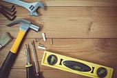 Vintage tone of assorted work tools on wood