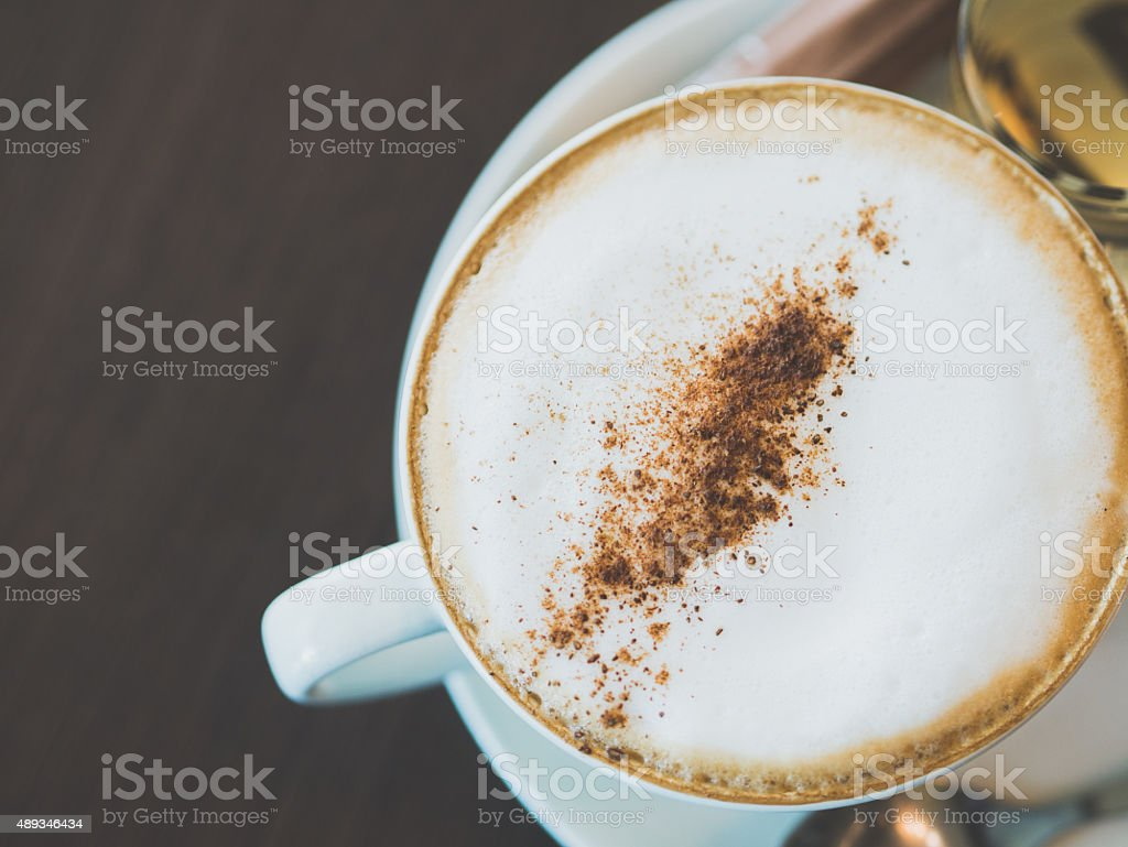 Vintage tone of cup of hot capuchino coffee. royalty-free stock photo