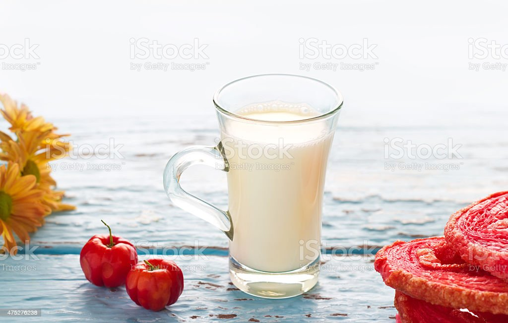 Vintage tone of glass milk and red flavored puffed fried stock photo