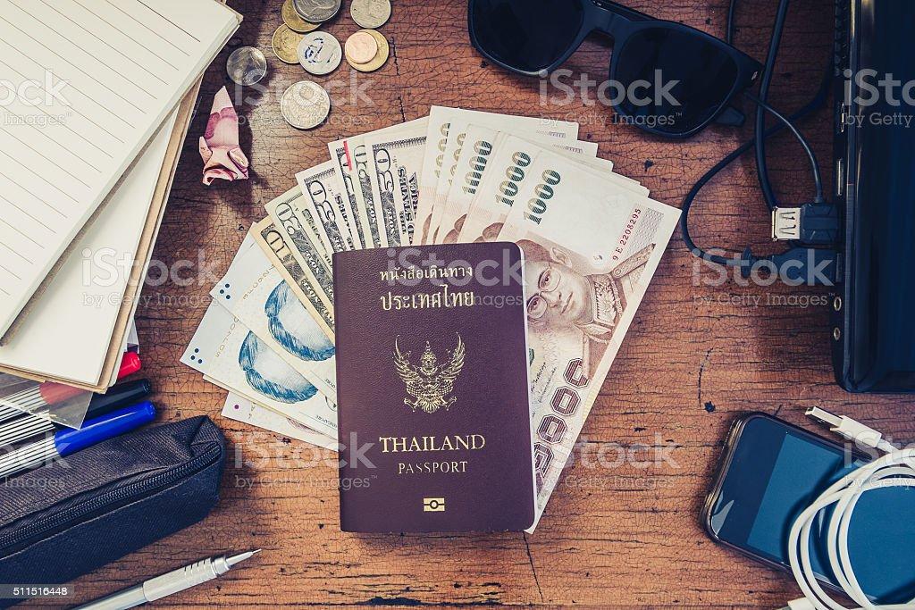 Vintage tone, travel preparation objects , passport, cash, gadget and etc. stock photo