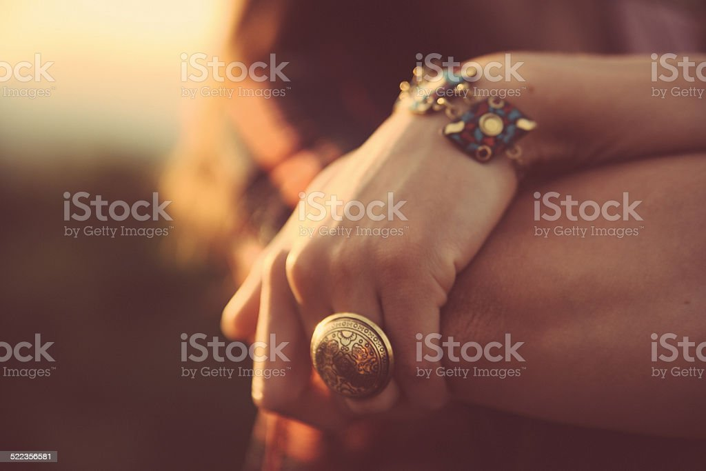 Vintage toned cross processed hand with jewelry stock photo