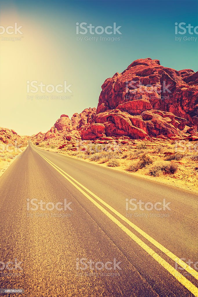 Vintage toned desert highway, travel concept, USA stock photo