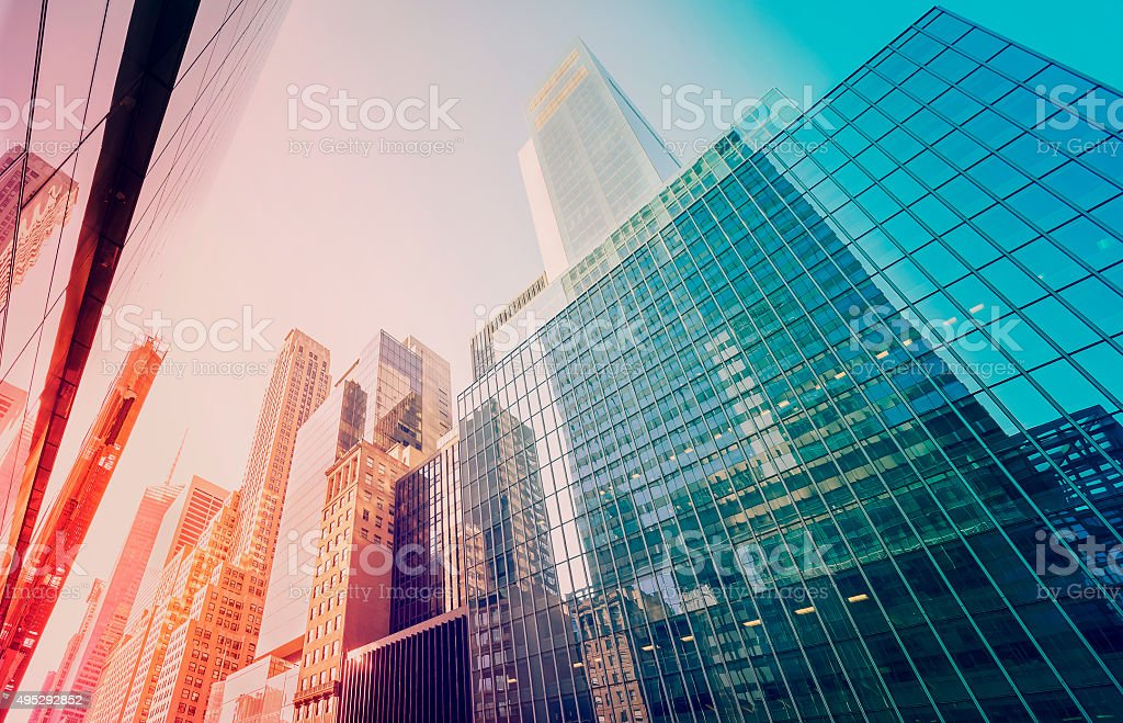 Vintage toned Manhattan skyscrapers at sunset, NYC, USA stock photo