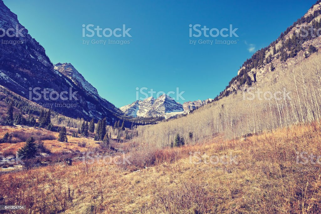 Vintage toned Maroon Bells mountain landscape. stock photo