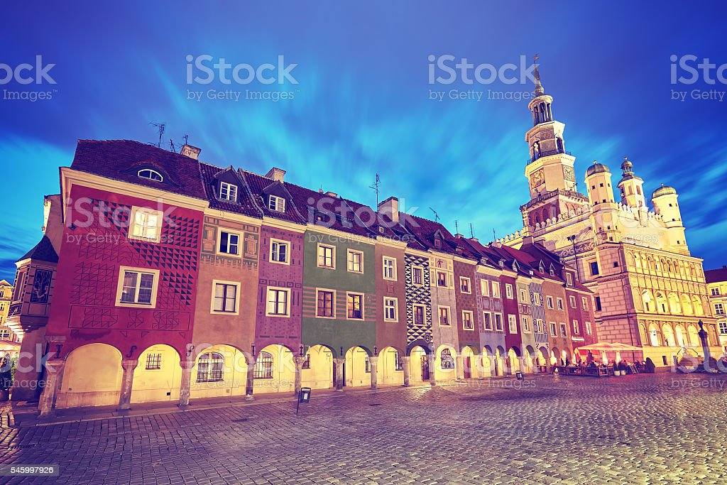 Vintage toned Old Market Square in Poznan at night. stock photo