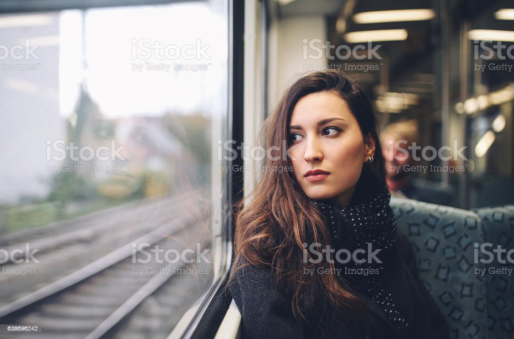 Vintage toned portrait of  a woman in Berlin metro train stock photo